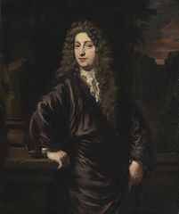 Portrait of a man holding a plinth