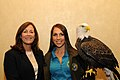 Posing for picture with Bald Eagle. (10596115503).jpg