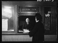 Postmaster Robert Pautz selling a war bond8d10667v.jpg