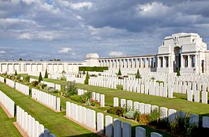 Pozières Memorial - View looking east across the cemetery, with colonnades of memorial panels in the background