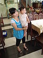Pregnant woman with a child Vietnam.jpg