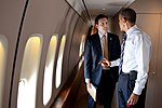 President Barack Obama talks with Principal Deputy Press Secretary Josh Earnest aboard Air Force One during a flight to Toledo, Ohio.jpg