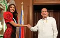 President Benigno S. Aquino III with Miss Tourism International 2013 Angeli Dione Gomez during her courtesy call on February 17, 2014.jpg