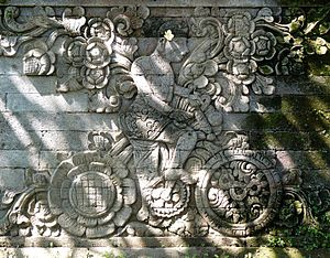 Pura Meduwe Karang - A bas-relief on the side of the main shrine in Pura Meduwe Karang is believed to be the depiction of Dutch artist W.O.J. Nieuwenkamp who explored Bali by bike in 1904.
