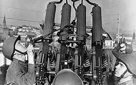 RIAN archive 41394 Anti-aircraft gunners getting a machine-gun ready for a fight.jpg