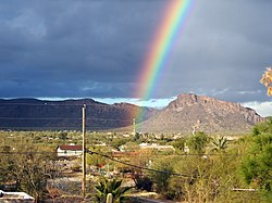 A rainbow appearing after a monsoon in Drexel Heights, Arizona, USA.