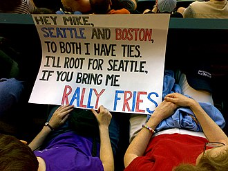 Seattle Mariners - Boston Red Sox fans holding a sign requesting rally fries.