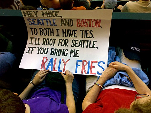Boston Red Sox fans holding a sign requesting rally fries. Rally fries sign.jpg