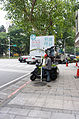 Real Estate Advertising Man Reading Notebook at Sidewalk of Section 5, Minsheng East Road, Taipei 20150613.jpg