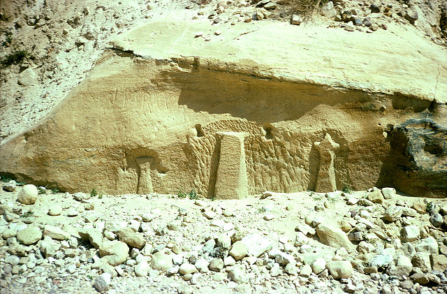 "A photograph of the inscription using the name ""Rekem"", the Nabatean name for Petra, sited opposite the entrance to the Siq in Petra, but now covered by the abutments of a concrete bridge."