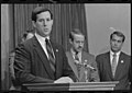 Representative Rick Santorum stands at a podium with Representatives John Boehner and Frank Riggs nearby.jpg