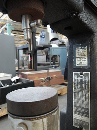 Rockwell scale - A closeup of the indenter and anvil on a Rockwell-type hardness tester.