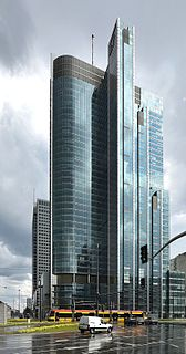 building complex in Warsaw, an office tower and shops with a parking building