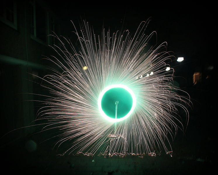 File:Rotating green fireworks in a wheel spinning Holland.jpg