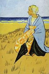 Breton woman sitting at the seashore.