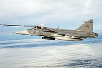 Saab JAS-39 of the Swedish Air Force undergoing inflight refuelling from a TP 84 Hercules (6802926928).jpg
