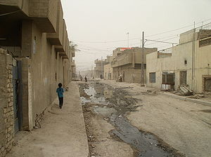 Sadr City - A young girl walks through Sadr City.