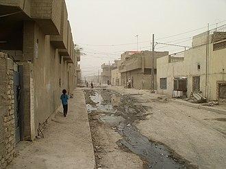 Sadr City - A young girl walks through Sadr City.