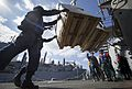 Sailors aboard USS Mason (DDG 87) receive cargo from the USNS Alan Shepard (T-AKE 3) (12467605155).jpg
