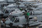 Sailors inspect an MH-60R Sea Hawk helicopter. (34573507942).jpg