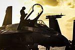 Sailors prepare an F-A-18E Super Hornet for flight operations on the flight deck of USS Dwight D. Eisenhower. (25686253473).jpg