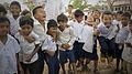School kids jumping in Cambodia (13578591625).jpg
