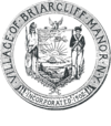 Circular seal with a central image of the coat of arms of New York, with a Native American to the left and a Colonial-era soldier to the right.