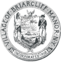 "Circular seal with a central image of the coat of arms of New York, with a Native American to the left and a Colonial-era soldier to the right. The seal's edge reads ""VILLAGE OF BRIARCLIFF MANOR · NY"" and ""INCORPORATED 1902""."