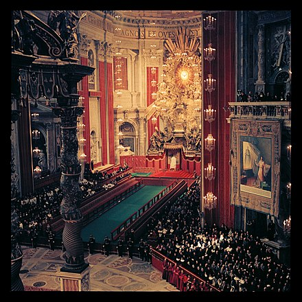 The interior of Saint Peter's Basilica. Prior to these years, the basilica was illuminated using beeswax candles, suspended on high chandeliers. Second Vatican Council by Lothar Wolleh 005.jpg