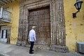 Secretary Kerry Admires a Door During a Walk Through the Historic District of Cartegena (29949979925).jpg