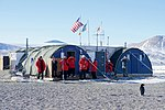 Secretary Kerry and his Traveling Party Look at an Adélie Penguin as it Approaches Them in Antarctica (30279240364).jpg