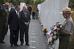Secretary of Defense Leon E. Panetta, second from left, and Patrick White, center left, the president of Families of Flight 93, look at the wall bearing victims' names at the Flight 93 National Memorial 120910-D-TT977-221.jpg