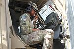 Signals NCO adjusts in Afghanistan 131023-A-MH103-096.jpg