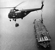 HUS-2 HMR-163 over USS Sicily (CVE-118) 1952
