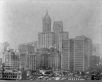 The newly completed Singer Building towering above the city, 1909.