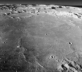 Sinus Medii - Oblique view facing south of central Sinus Medii from Lunar Orbiter 2, showing Bruce crater at right and Oppolzer crater above left