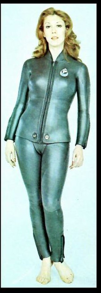 "Wetsuit - Woman wearing ""smoothskin"" wetsuit with ""beavertail"" and twistlock fasteners"