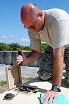 Soldiers volunteer to clean up GITMO DVIDS200969.jpg