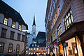 St. Michael's Church (Michaelerkirche) clocktower as seen from the streets of Vienna. Austria, Western Europe.jpg