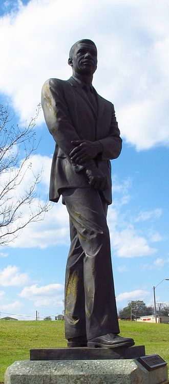 Medgar Evers - Statue of Evers at the Medgar Evers Boulevard Library in Jackson, Mississippi