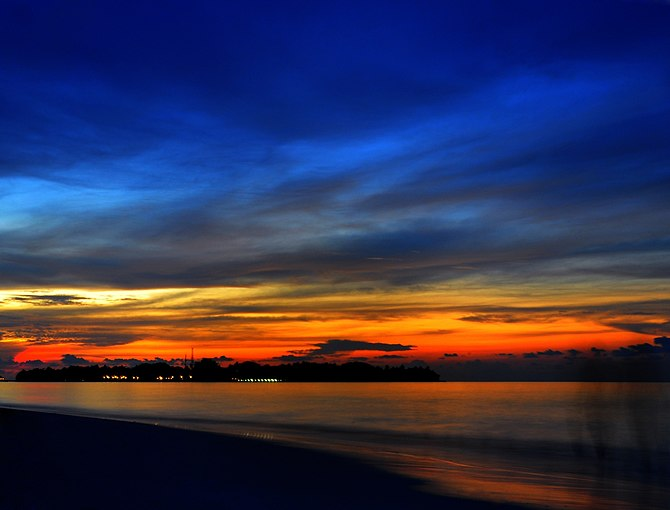 Sunset in the Maldive Islands, officially the ...