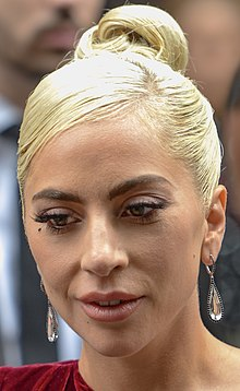 A close-up of Lady Gaga, as she is looking away from the camera.