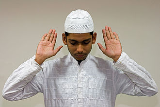 Salah - A Muslim raises his hands to recite Takbeeratul-Ihram in prayer