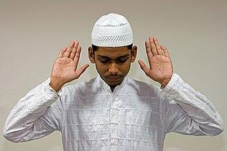 Salah - A Muslim raises his hands to recite Takbeeratul-Ihram in prayer