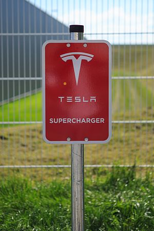 Tesla Supercharger - Tesla logo at Supercharger station