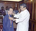 The Minister of State (Independent Charge) for Overseas Indian Affairs, Shri Jagdish Tytler presenting 'Pravasi Bhartiya Samman – 2005' to renowned author, Shri Vikram Seth in New Delhi on April 19, 2005.jpg