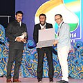 The Minister of State for Information & Broadcasting, Col. Rajyavardhan Singh Rathore and Actor Jackie Shroff presenting the Silver Peacock award for Best Actor (Male) to Alexel Serebriakov for the movie Leviathan.jpg