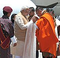 The Prime Minister, Shri Narendra Modi being received by the Prime Minister of Bhutan, Mr. Lyonchhen Tshering Tobgay, on his arrival at Paro International Airport, in Bhutan on June 15, 2014.jpg