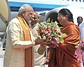 The Prime Minister, Shri Narendra Modi being welcomed by the Chief Minister of Rajasthan, Smt. Vasundhara Raje Scindia, on his arrival, at Jaipur on August 21, 2015.jpg