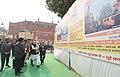 The Prime Minister, Shri Narendra Modi walks through an exhibition highlighting the progress of Integrated Power Development Scheme (IPDS), at Kabir Nagar, in Varanasi, Uttar Pradesh on December 22, 2016.jpg